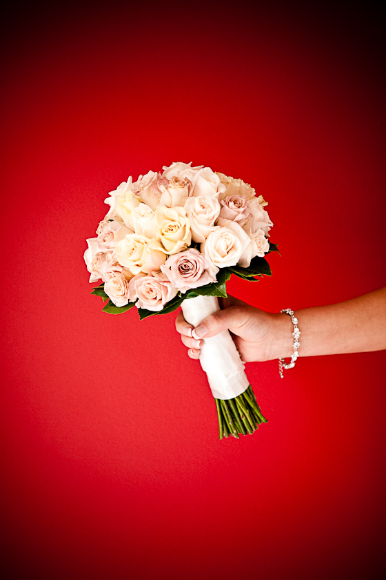 Bridal bouquet against a red wall