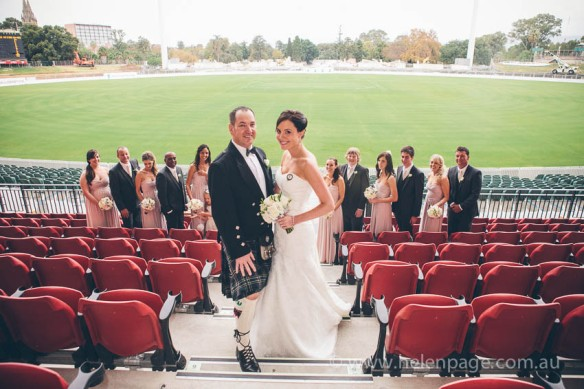 Bride and Groom at Adelaide Oval on the granndstad after wedding